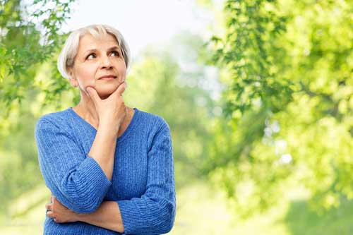 Older woman pondering health care questions