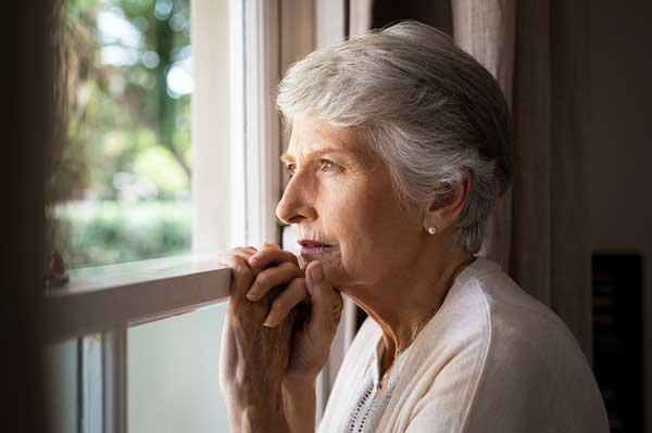 Senior woman at home pondering diagnosis