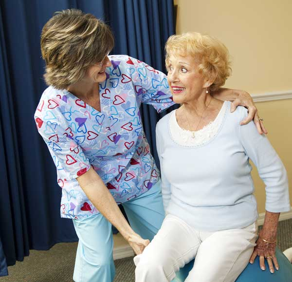 Physical therapist applying physical therapy to patient