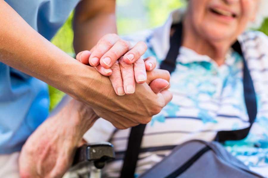 Qualities of a Caregiver - a Caregiver assisting a patient